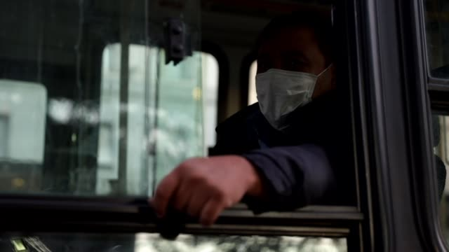 a bus driver wears a protective mask during the first day of quarantine on march 20 in buenos aires argentina president alberto fernandez declared a... - social distancing stock videos & royalty-free footage