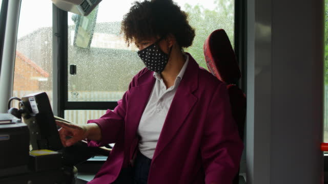 bus driver welcoming passengers onboard - bus driver stock videos & royalty-free footage