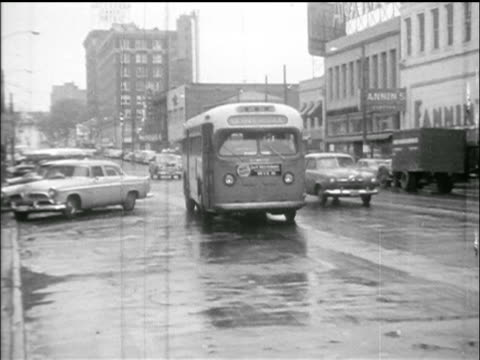 B/W 1955 bus driving on street toward camera / Montgomery Bus Boycott AL / newsreel