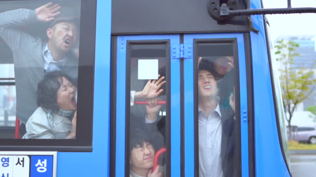 a bus filled with people - bus stock-videos und b-roll-filmmaterial