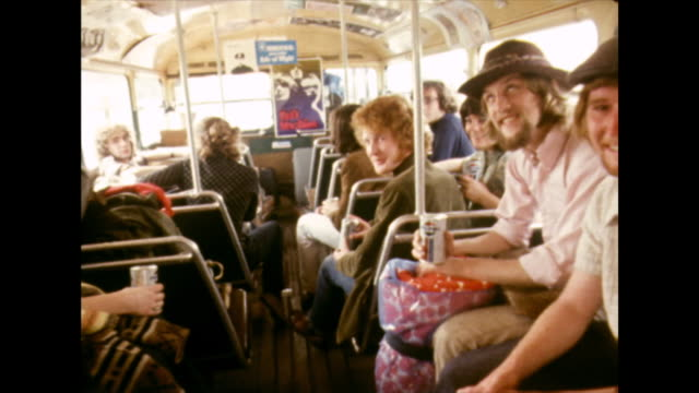 bus full of hippies drives to isle of wight festival; 1970 - double decker bus stock videos & royalty-free footage