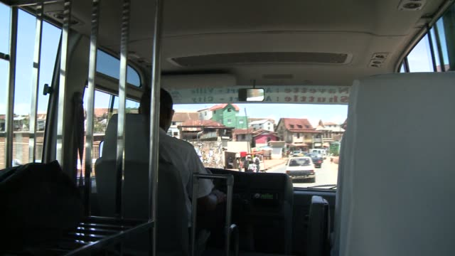 a bus moves through a town in madagascar. available in hd. - bus driver stock videos & royalty-free footage