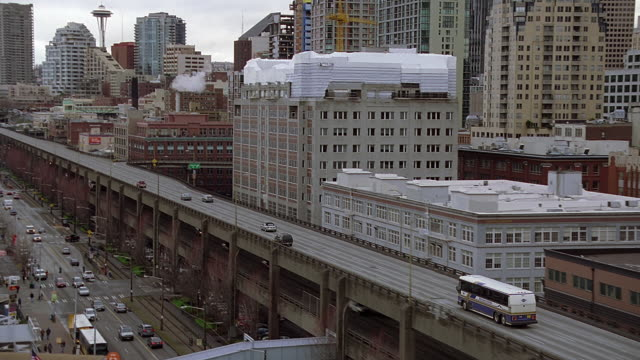 ws ts bus moving on seattle freeway and view of skyline / seattle, washington, usa - underpass stock videos & royalty-free footage