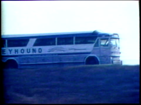 1973 montage ws pan bus moving past/ pov ws driving past factory/ usa/ audio - 1973 stock videos and b-roll footage