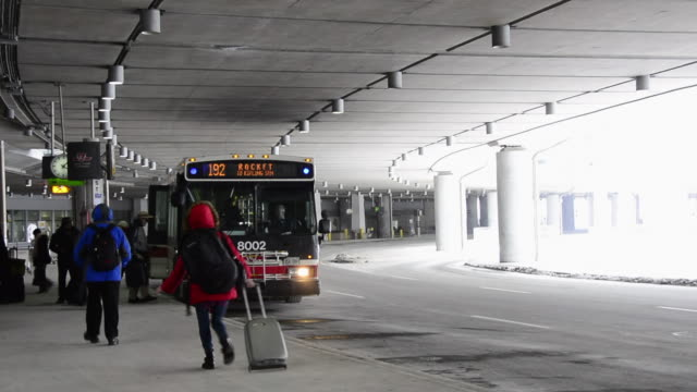 ttc bus of the 192 express route picking up passengers at the arrivals area the bus serves from the airport to the kipling station the landmark is... - toronto stock videos & royalty-free footage
