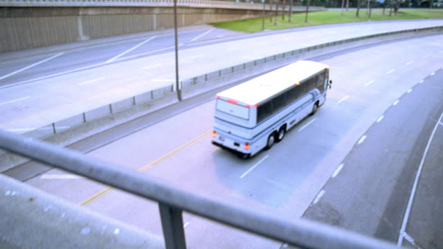 a bus passes under a freeway overpass. - 2004 stock videos & royalty-free footage