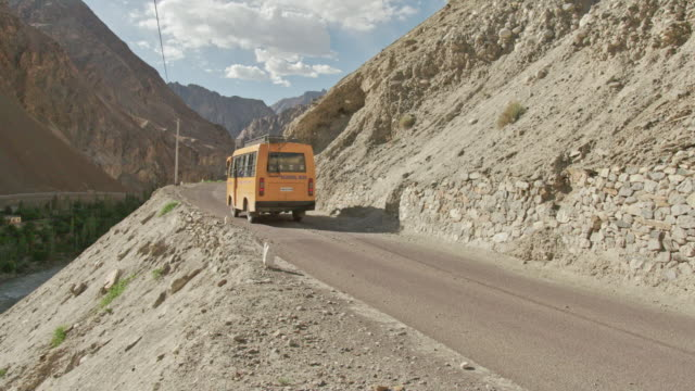 bus passing on mountain roads - bus stock videos & royalty-free footage