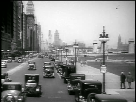 B/W 1929 bus point of view of traffic + buildings on Michigan Avenue / Chicago, Illinois / newsreel