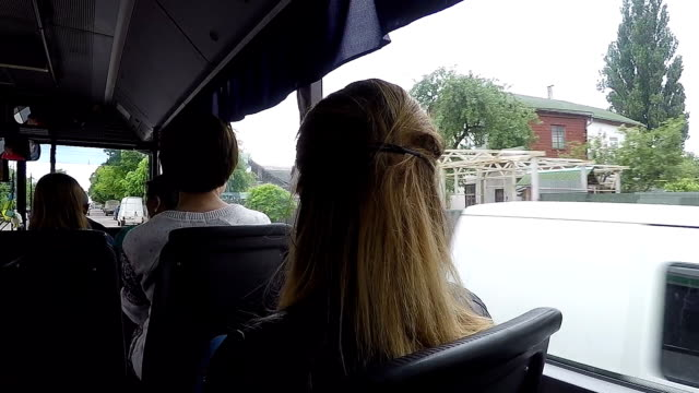 bus rides around the city. - tour bus stock videos and b-roll footage