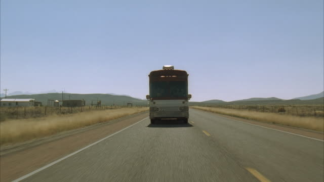 WS, Bus riding on desert highway, Texas, USA