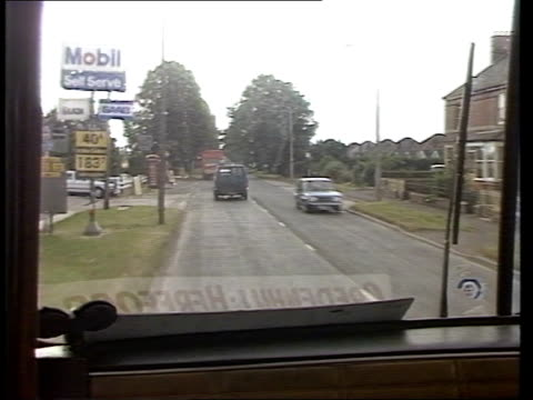 bus services; england: herefordshire: people standing at bus stop midland red bus drives by followed by stretton coaches bus stretton coaches bus... - herefordshire bildbanksvideor och videomaterial från bakom kulisserna