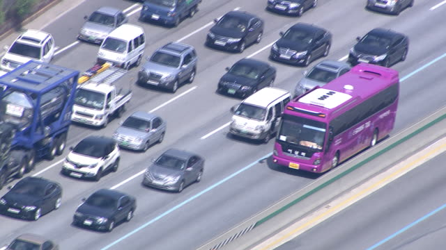 a bus speeding on the busway at the highway - aufblenden stock-videos und b-roll-filmmaterial