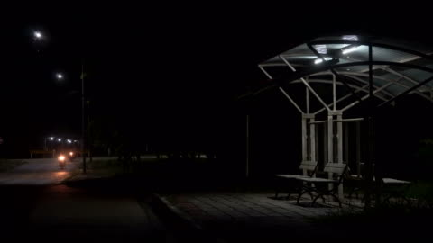 bus stop at night. shot on horror cinema - bus stock videos & royalty-free footage