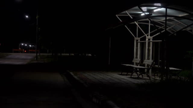 bus stop at night. shot on horror cinema - stop sign stock videos and b-roll footage