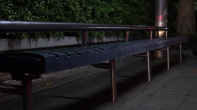 bus stops are empty, there are no people on the streets of the city at night. - bus stop stock videos & royalty-free footage