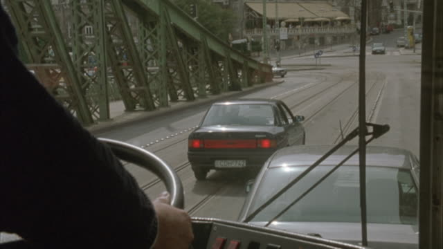 A bus swerves to miss an exploding car on the Liberty Bridge in Budapest.