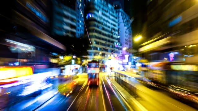 bus through city with blur motion building - vibrant color stock videos & royalty-free footage