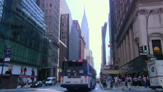 la bus, traffic, and taxis at street level, with the empire state building beyond / new york city, new york, united states - level stock videos and b-roll footage