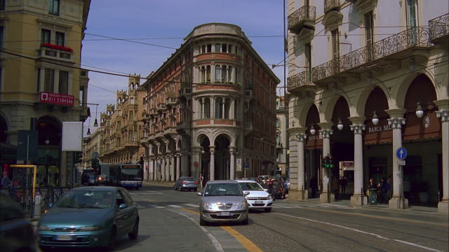 ms pan bus, traffic on city street, turin, italy - taxi stock videos & royalty-free footage