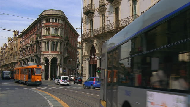 ms bus, tram and traffic on city street, turin, italy - tram stock videos & royalty-free footage