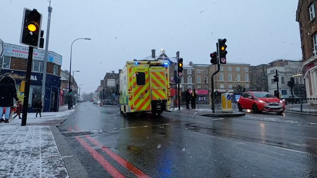 buses and an ambulance moves down forest hill as snow begins to fall on january 24, 2021 in london, united kingdom. parts of the country saw snow and... - snow stock videos & royalty-free footage