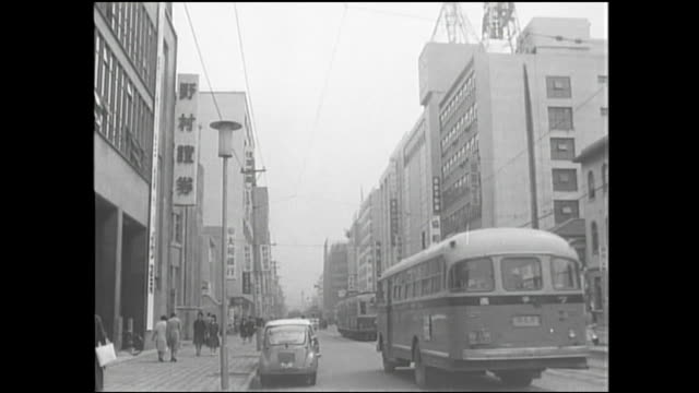 Buses and streetcars move through Fukuoka's Tenjin area.