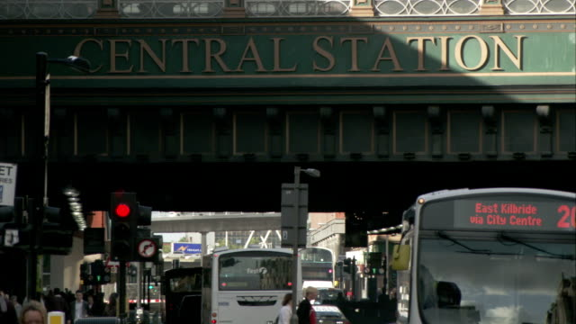 buses bring passengers to and from the glasgow central station in scotland. available in hd. - bus stock videos & royalty-free footage