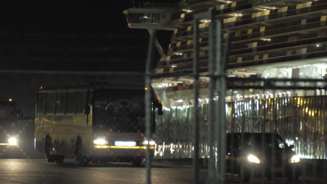 buses carrying british passenger leaving the diamond princess cruise ship to bring them home after they had been held in quarantine due to the... - ship stock videos & royalty-free footage