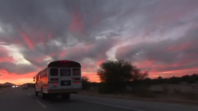 buses carrying central american migrants cross the mexican sonoran desert as they continue to head to tijuana where they will join the rest of a... - nutzfahrzeug stock-videos und b-roll-filmmaterial