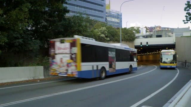 buses cross at tunnel entrance - bus stock videos & royalty-free footage