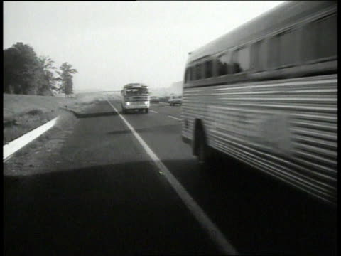 vídeos de stock e filmes b-roll de montage buses driving down the highway to the civil rights march on washington / new york new york united states - 1963