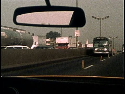1975 MONTAGE Buses driving on dedicated bus lanes on streets and highways / United States
