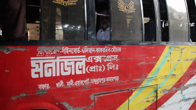 Buses in Dhaka many of them are badly damaged