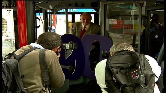london bus fares cut for oyster card holders; england: london: ext ken livingstone posing for photocall as sits in driver's seat of london bus... - number 9 stock videos & royalty-free footage