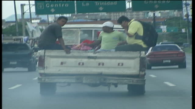 london mayor agrees cheap oil deal for subsidised fares; tx 6.11.2006 venezuela: caracas: young men in back of pickup truck in heavy freeway traffic... - caracas stock videos & royalty-free footage