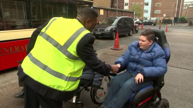 london wheelchair users take their complaints to stockwell bus garage; england: london: stockwell bus garage: ext bus passenger chris stapleton,... - stapleton stock videos & royalty-free footage