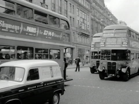 buses move along upper regents street in london. 1957. - doppeldeckerbus stock-videos und b-roll-filmmaterial