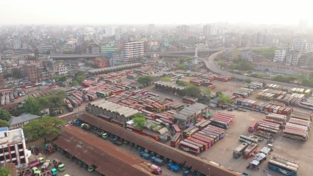 buses parked in the terminal in dhaka city during government-imposed lockdown as a preventive measure against the covid-19 coronavirus in dhaka,... - stationary stock-videos und b-roll-filmmaterial