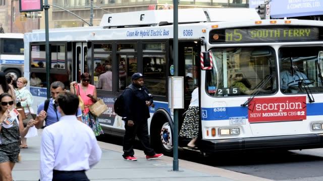 buses summer morning rush hour traffic public transportation buses mass transit midtown manhattan 42nd street 5th avenue new york city usa m1 m2 m3... - 42nd street stock videos & royalty-free footage
