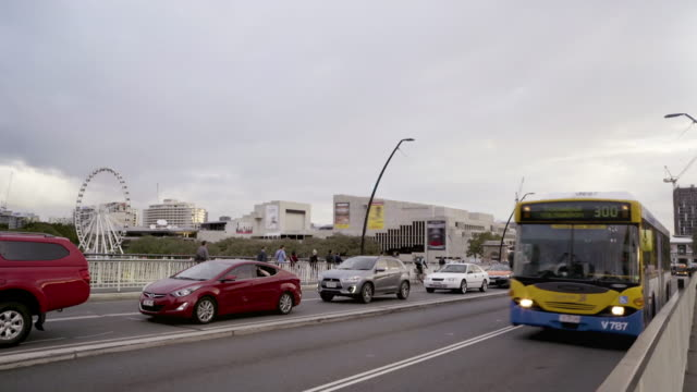 buses traveling across a bridge during rush hour - public transport stock videos & royalty-free footage
