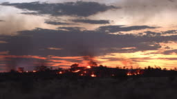 Bush fires burning at twilight in rural areas of Outback Australia. Queensland.