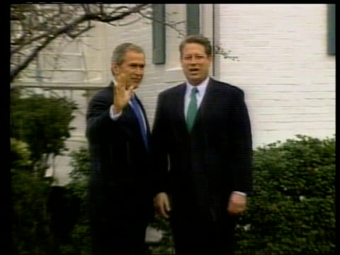 washington dc george w bush along to shake hands with al gore as snow falling zoom in bv bush with gore ms gore along with bush as answering press... - gore stock videos and b-roll footage