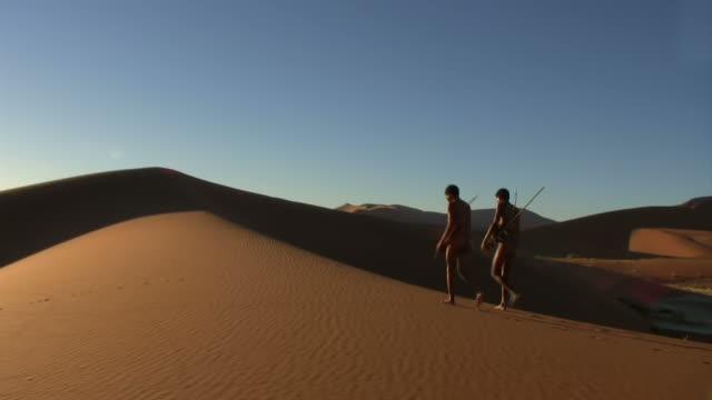 Bush people on namib dunes