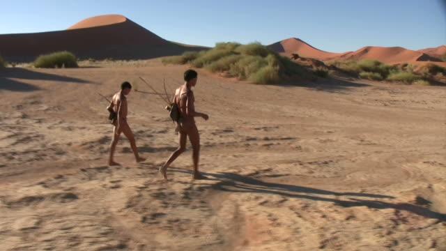 Bush people walking in Namib desert