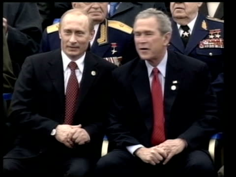 Moscow EXT Military flypast TGV Audience President George WBush and wife Laura Bush sitting with Russian President Vladimir Putin MS Putin sitting...