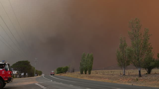 bushfires approach and impact on the countryside near the small rural village of bredbo, new south wales , australia, on saturday, february 1, 2020. - fire engine stock videos & royalty-free footage