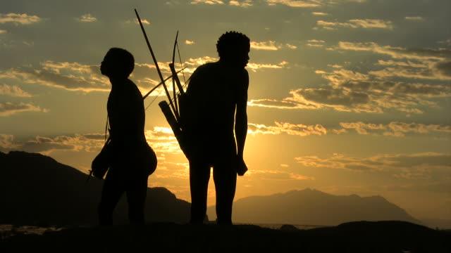 bushmen at sunset