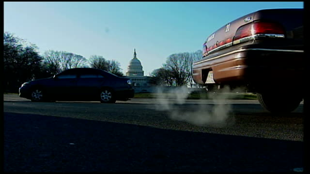 bush's ecocredentials suffer another blow ext united states capitol building clsoe shot of exhaust pipes of cars with capitol building in background... - emitting stock videos & royalty-free footage