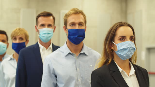 busiess people wearing face masks during covid-19 pandemic - smart casual stock videos & royalty-free footage