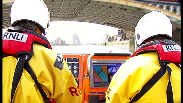 busiest lifeboat station is in london; lifeboat along crew member view from lifeboat as along river wake of lifeboat cima piloting lifeboat along... - amphibious vehicle stock videos & royalty-free footage